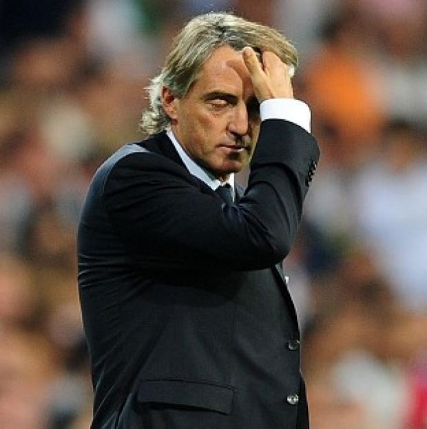 Swindon Advertiser: Roberto Mancini took responsibility for Manchester City's defeat at Ajax.