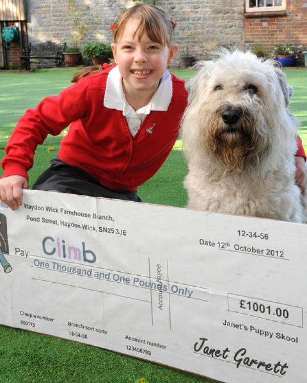 Chloe Harnett accepts the cheque for C.L.I.M.B from Janet's Puppy Skool