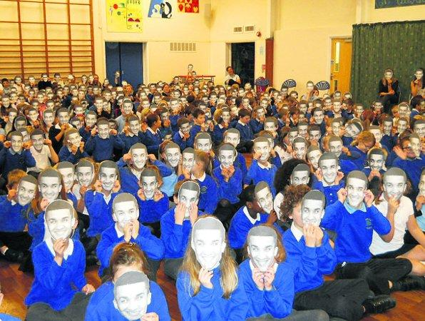 Children at Woughton Junior School with their Jahmene masks