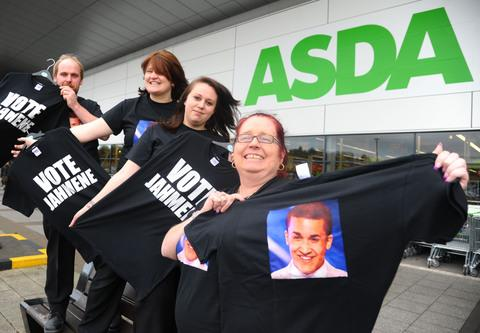 Asda staff Simon Barrow, Lee Carter, Hayley Edmonds and Jo Carter with the T-shirts