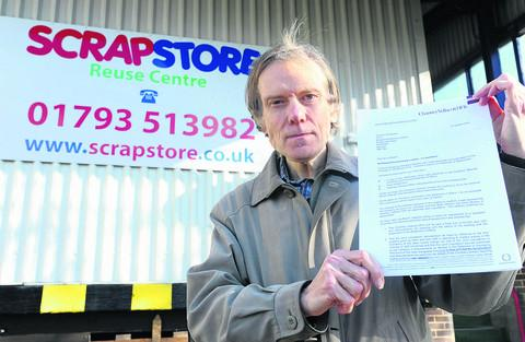 Owner David Rewcastle with the letter notifying the Scrapstore of the bad news