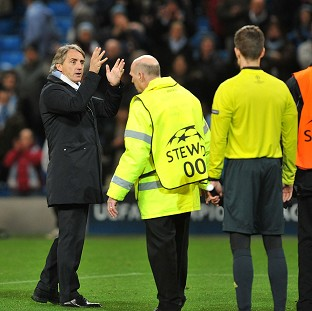 Roberto Mancini, left, had confronted the referee after Manchester City's game against Ajax