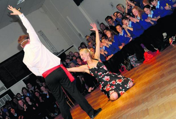 STRIKE A POSE Mark Nye and Hanah McLaughlin perform at Highworth Warneford School's Strictly Come Dancing show     Pictures: DAVE COX