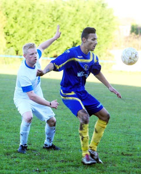 Wootton Bassett's Ethan Delaney in action against Brimscombe