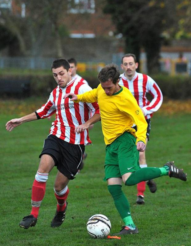 Swindon Advertiser: Action from Lower Stratton's clash with Queensfield