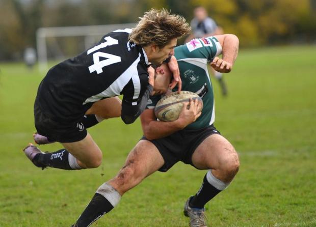 Wootton Bassett's Andrew Phoenix attempts a tackle on Tom Brown
