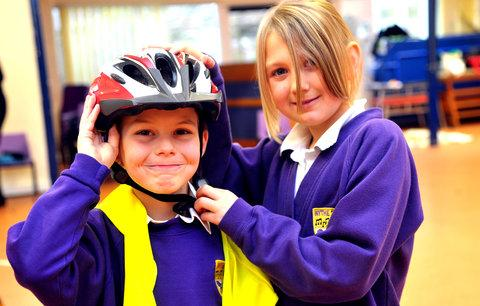 Tommy and Lydia take part in the road safety event with the charity Brake at Nythe Primary School