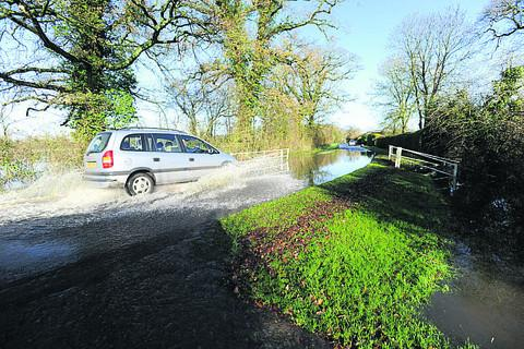 flooding at Ashton Road near Minety where  the waters in the brook flowed on to the road