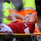 Swindon's Alan Navarro suffers his latest injury against Coventry