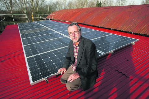 Matt Holland with the solar panels