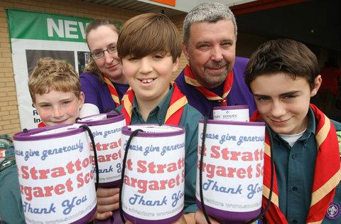 Terry Shipp, back right, with members of the 1st Stratton St Margaret scout group collecting donations for the Woodlands trust