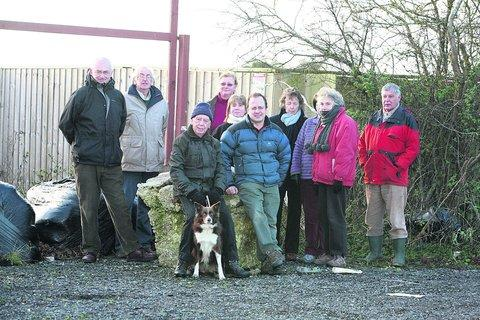 Campaigners at the proposed entrance to a new travellers camp near Watchfield