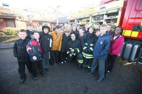 Firefighter Dave Slawinski with children from Westlea Primary School