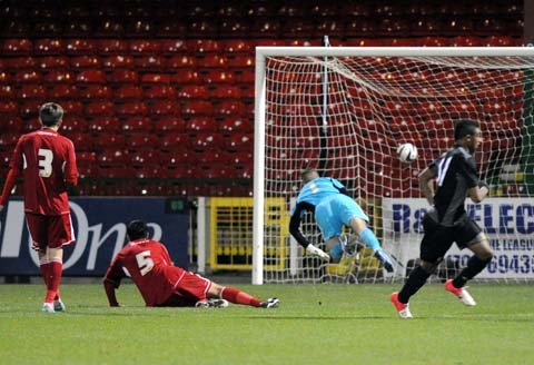Robins' cup dream dashed by Liverpool