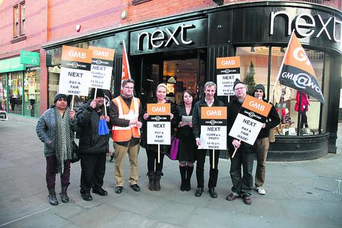 Members of the GMB Union protesting outside the Next store in Swindon over low pay for its staff