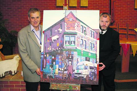 From left David Wray, the chief executive officer for Voluntary Action Swindon and Pat Broderick who raised money for the canvas print which was presented at the celebration on Friday