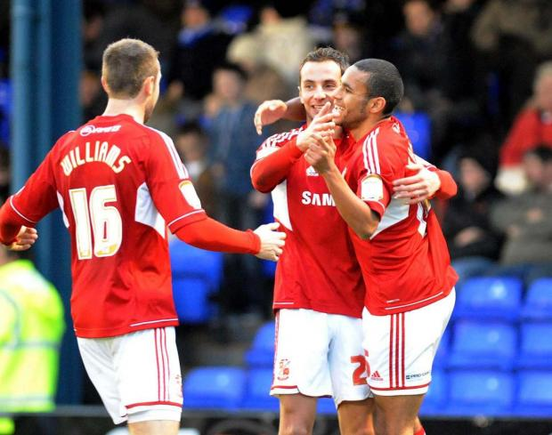 MAKING THE DIFFERENCE: Raffa De Vita is mobbed after scoring at Oldham