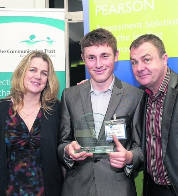 Celebrating Jack Fradgley, centre, being handed an outstanding achievement award from sponsors Pearson Assessment