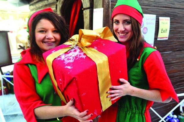Emma Dunn with fellow elf Hollie Delphin Pictures: JAMES DOUGLAS