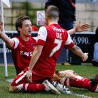 Swindon Advertiser: David Mooney celebrates his goal with Dean Cox: Simon O'Connor