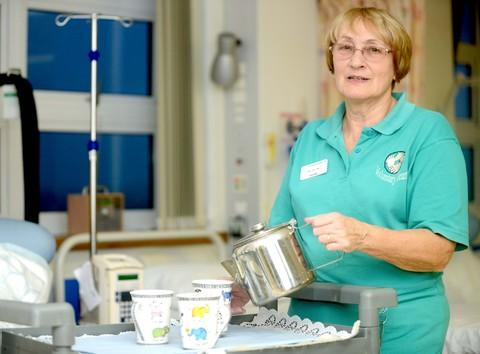 Volunteer Sue Harvey pours a cuppa