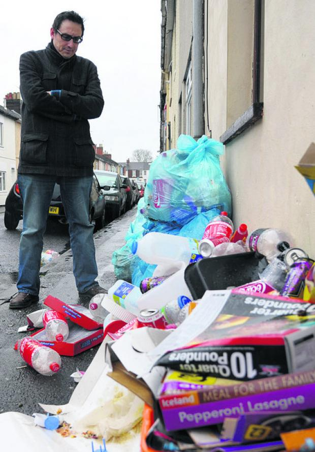Gaute Lindkvist with some of the rubbish left in Albion Street