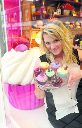 Jessie Dennis with her cakes at her shop GlamoRose Cakes