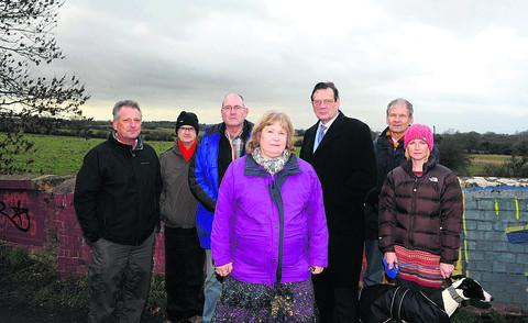 Swindon Advertiser: Residents and councillors are unhappy at plans for homes on Ridgeway Farm. From left, Kevin Fisher, Martyn Parrott, Nick Fisher, Jacqui Lay, Garry Perkins, Roger Ogle and Paula Russell with Otis
