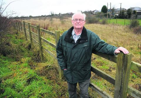 Stuart Boyd, Blunsdon St Andrew Parish Council chairman, at the site of the proposed houses