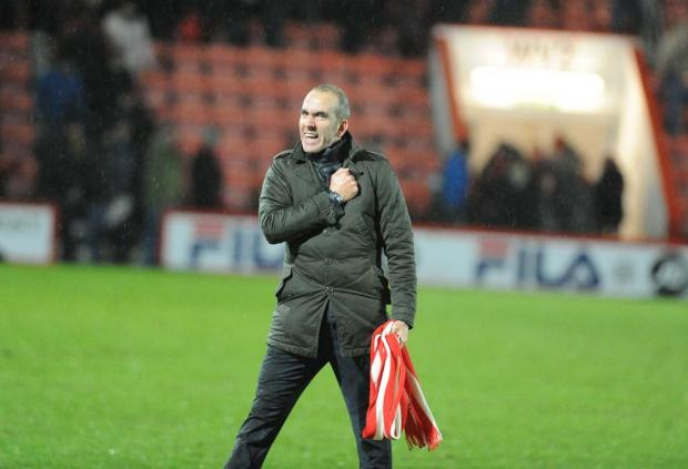 ON THE ROAD AGAIN: Paolo Di Canio celebrates a point at Bournemouth