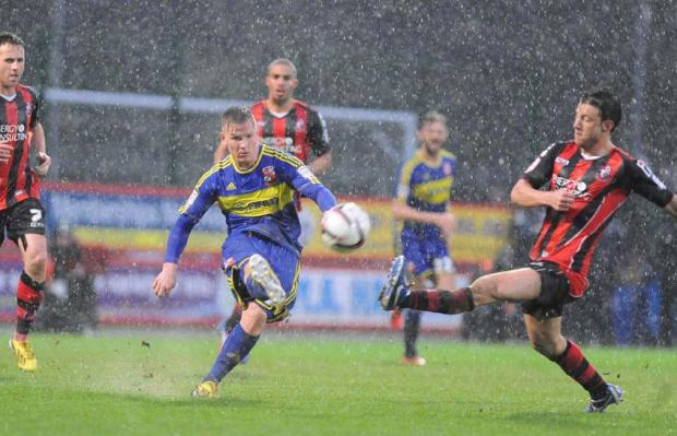 WET WET WET: Matt Ritchie tries to get to grips with conditions at Bournemouth