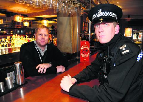 Danny Mason, vice chairman of Pubwatch and Revolution general manager, with Sergeant Graham McLaughlin