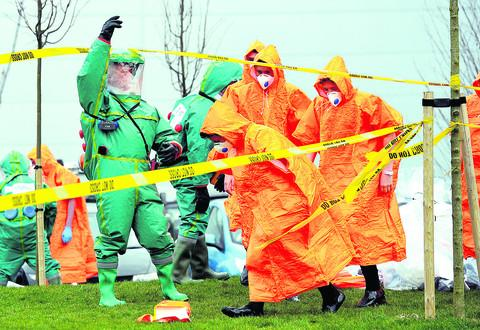 Swindon Advertiser: The fire service team organises the decontamination procedure with the students