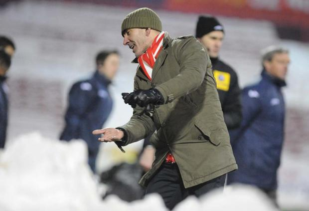 Paolo Di Canio has dedicated Town's win against Shrewsbury to the club's snow-shifting fans