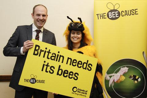 Swindon North MP Justin Tomlinson with the Friends of the Earth bee