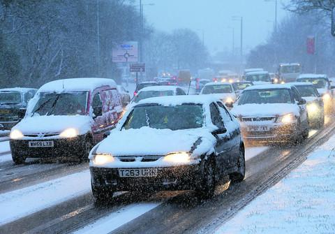 Swindon Advertiser: Motorists struggle along Great Western Way in the snow last Friday