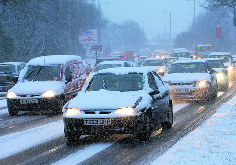 Motorists struggle along Great Western Way in the snow last Friday