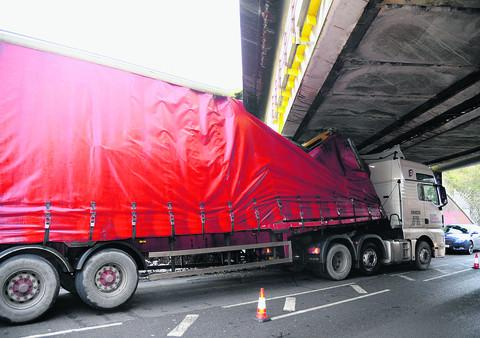 The lorry wedged under the Running Horse Bridge at Wootton Bassett Road
