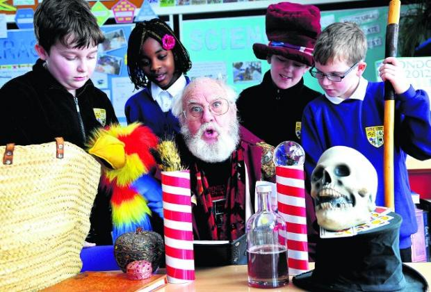 MAGICAL EXPERIENCE Norman Newt with, from left, Nythe Primary School pupils Jonathan, Eniola, Calum and Edison Picture: JAMES DOUGLAS