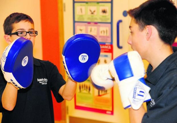 boxing clever Rob and Jordan take part in the Scrappers boxing session Picture: DAVE COX