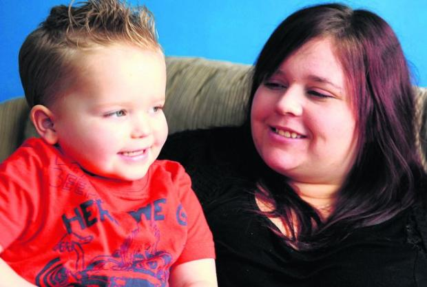 Kieran Lower with his mum Jalie Antal- but which company offered to pay for his operation?