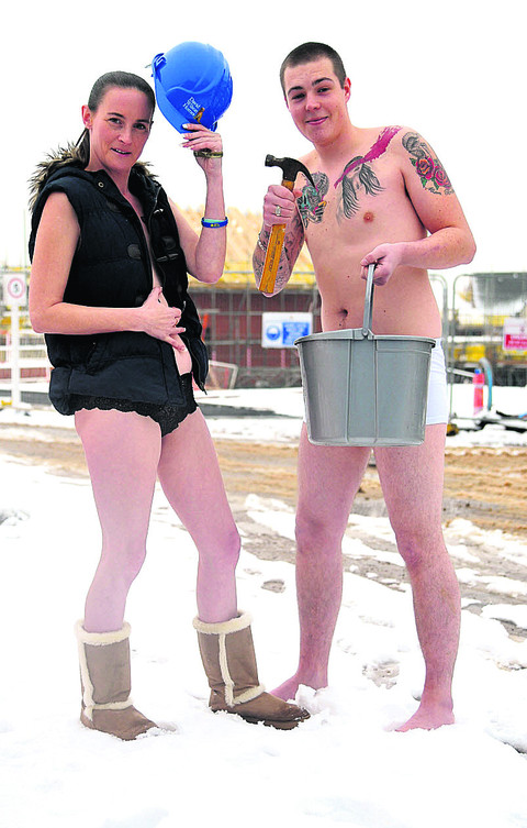 Marie Hughes and Jamie Madden strip off at a building site at Royal Wootton Bassett