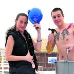 Swindon Advertiser: Marie Hughes and Jamie Madden strip off at a building site at Royal Wootton Bassett