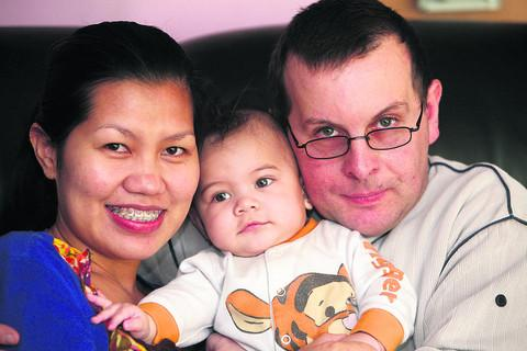 Mark Cammack with his wife Jorlie and son Colin at their home in Cricklade. Jorlie faces deportation from this country
