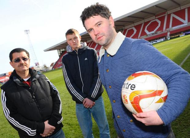 Swindon Advertiser: Former ball boy Adam Wainwright (far right), Town's head ball boy Bradley Carter (centre) and ball boy co-ordinator Joe Prinzi
