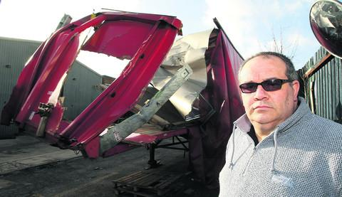 Jason Ellen, who owns Ellen Express Transport in Swindon, with the damaged lorry which crashed in Wootton Bassett Road bridge last week