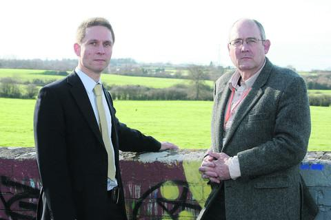 Councillors Keith Williams and Nick Martin looking over Ridgeway Farm, near West Swindon, where 700 new homes are set to be built