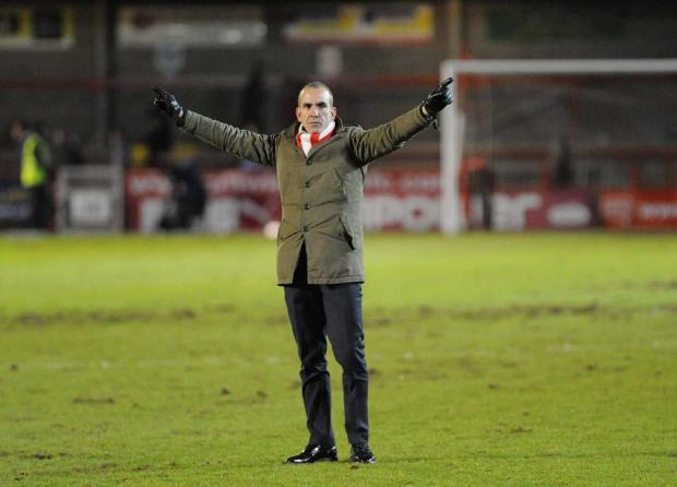Swindon Advertiser: THREAT: Paolo Di Canio saltues the fans at Crawley