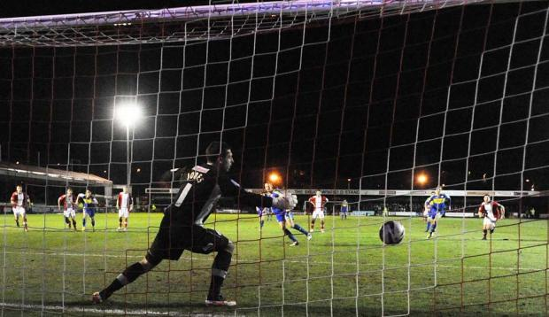 SPOT ON: Adam Rooney's penalty earns Swindon a point