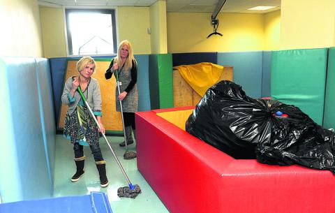 Staff at Uplands cleaning up after the flood earlier this week